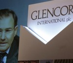 Glencore CEO Ivan Glasenberg is broadcast on a screen during a tele-conference in Hong Kong